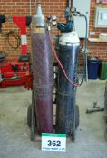 A Steel Oxy-Acetylene Bottle Trolley with Gauges, Hoses, Torch and A Selection of Ten Nozzles (