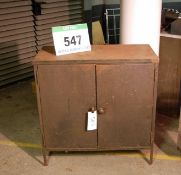 A Green Steel Double Door Tool Cabinet with fitted Internal Shelf
