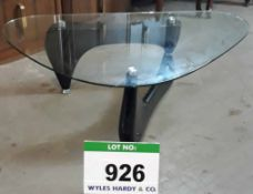A Glass Topped Kidney Shaped Side Table on 2-Section Black Stand