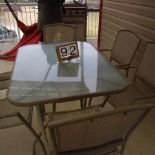 Patio table, glass top & 6 chairs