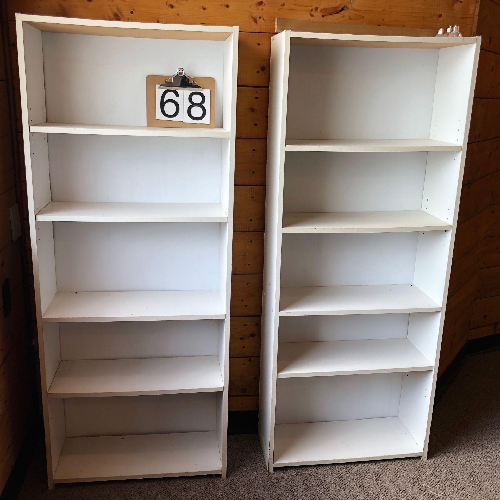 Two white bookshelves