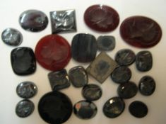 24 polished Haemite & Carnelian polished stones most with head intaglios