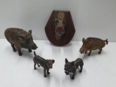 Collection of dog & wild boar related items, including a small plaque and brass/bronzed small cast