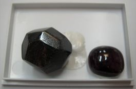 2 large Garnets - the smaller a polished cabochon