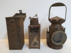 2 old metal railway lanterns, 1 a 1918 Howes & Burley compete with outer metal case, the other a