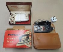 "Boxed, vintage Remington electric shaver together with a boxed vintage ""Pifco"" travel iron (2),"
