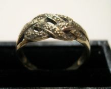 9ct yellow gold & diamond rope twist ring Approx 2.2 grams gross, size K/L