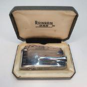 Mid 20thC Ronson metal gas lighter in original case