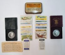 Interesting collection of cigarette cards, small metal tin and 2 cased festival of Britain crowns (