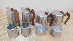 2 sets of vintage Picquot Ware tea sets, comprising of 2 tea pots, 2 hot-water pots, milk jug &