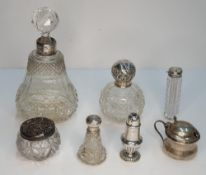Various items of English silver to include silver toped scent bottles, jars, etc (7) some slightly