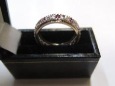 9ct yellow gold eternity ring with diamond & pink sapphire Approx 2.8 grams gross, size P