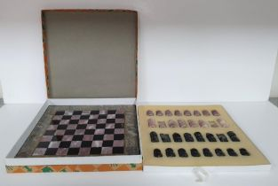 Fine quality, complete (32 pieces) onyx carved chess set and onyx board in its original box