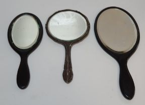 Silver backed hand mirror (330 grams gross) together with 2 similar ebonised wood examples (3)