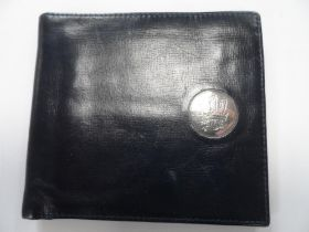 Leather wallet with unmarked silver coloured disc bearing the Prince of Wales feathers & was