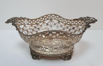 London silver pierced bowl with ribbon handle (660 grams)