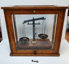 Cased set of balance scales (complete) by Phillip Harrison of Birmingham, 46 cm long, Small crack to