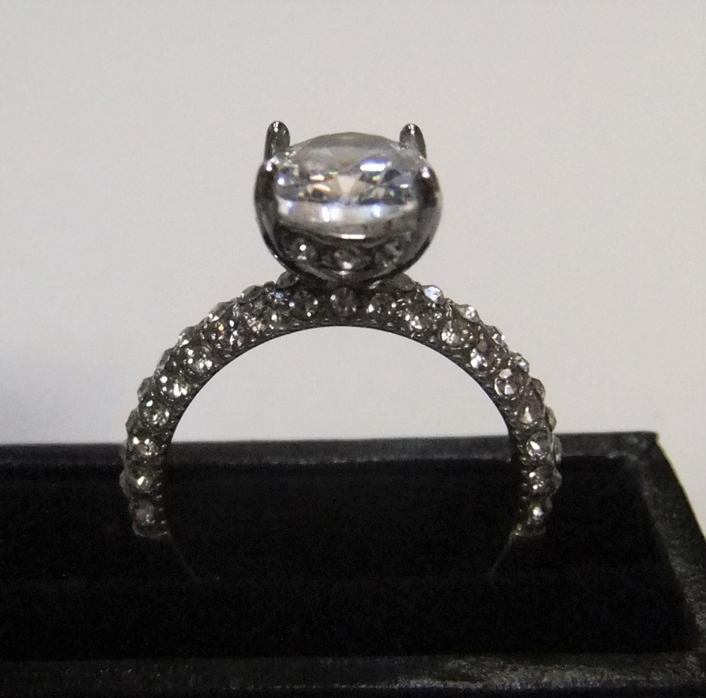 14ct white gold with large CZ solitaire stone with addional CZ stones addorning the upper part of