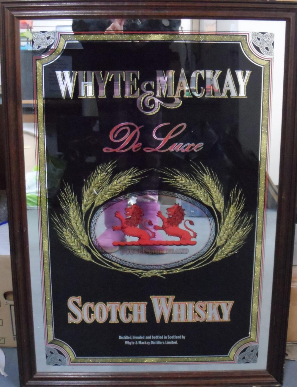 Whyte & MacKay, Scotch whiskey advertising mirror in oak frame, The mirror measures 80 x 52 cm