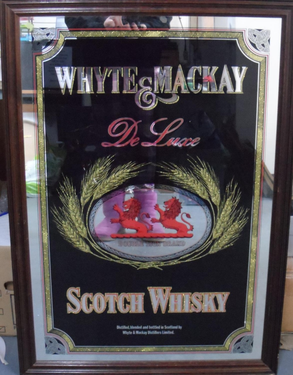 Whyte & MacKay, Scotch whiskey advertising mirror in oak frame, The mirror measures 80 x 52 cm - Image 2 of 2