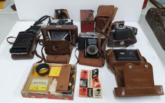 Collection of vintage 20thC cased cameras to include Kershaw & Konica examples together with a small