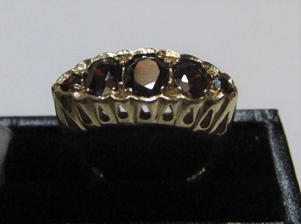 9ct yellow gold 5 garnet ring Approx 4.2 grams gross, size O