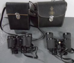 Pair of Tasco 8 x 40 cased binoculars together with another vintage pair of 8 x 30 cased