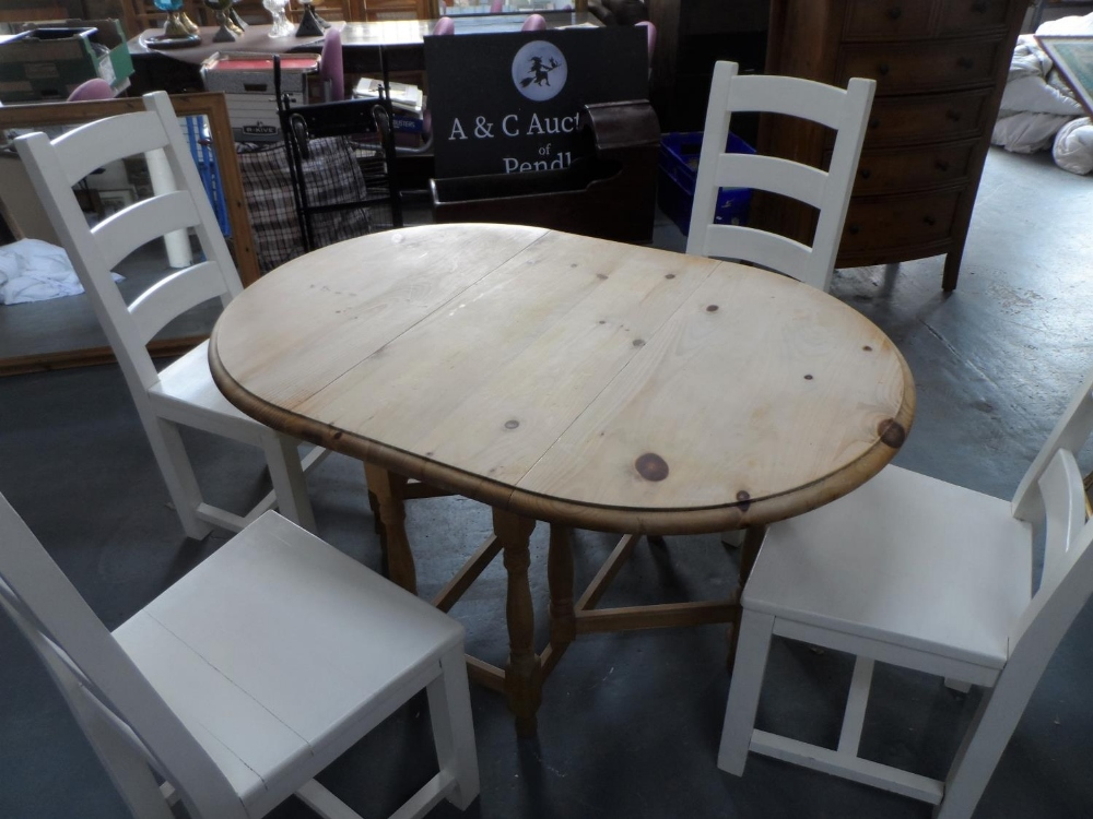 Drop leaf pine table with 4 solid wood (painted) chairs, The table measures 90 x 133 cm