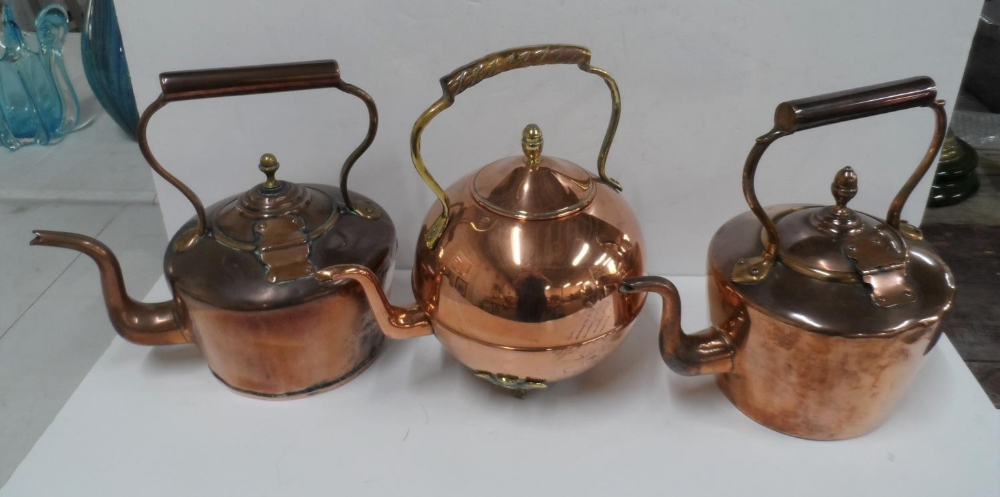 Collection of 3 copper antique kettles to include an unusual circular example (3)