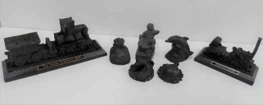Seven collectable items made from British coal including a copy of Stephenson's Rocket etc (7)