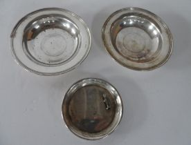 3 Edwardian circular silver shallow dishes, one with a small Scottie dog (3), 2 x 15cm dimeter, 1