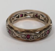 Unmarked metal eternity ring inset with diamonds & rubies round the entire ring, 3.5 grams gross,