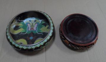A Chinese cloisonné enamel dragon decorated bowl on wooden plinth, Appears in fine condition, 20