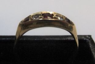 18ct yellow gold boat shaped ring with rubies & diamonds Approx 2.7 grams gross, size O/P