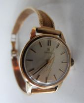 A vintage unboxed Omega 9ct gold ladies watch set to a 9ct gold bracelet strap, 19 grams gross