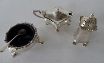 Edwardian silver condiment set with blue inners (3)
