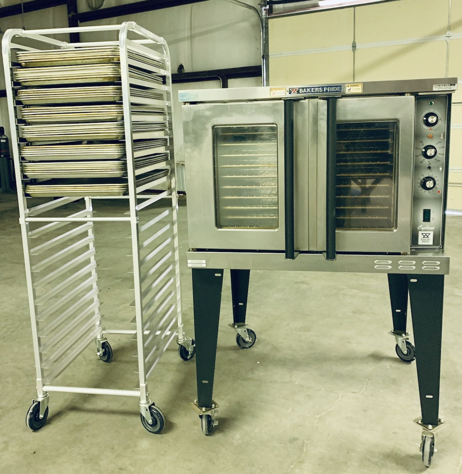 Used Bakers Pride Cyclone Series Single Deck Full Size Electric Decarb Oven. Model BCO-E1w/ 39 trays