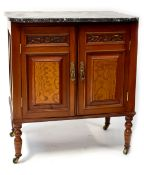 An Edwardian-style walnut marble-top wash stand with pair of carved panelled cupboard doors,