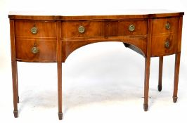 A George III mahogany bow-fronted sideboard with central drawer flanked by two deep drawers,