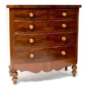 A Victorian Scottish bow-fronted chest of two short over three long drawers, on turned feet,