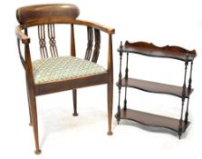 An Edwardian inlaid mahogany open elbow chair with pierced splats and drop-in seat,