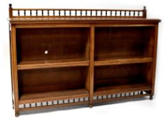 A late Victorian walnut freestanding bookcase with bobbin turned gallery above two sections,