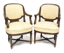 A pair of 19th century carved walnut open armchairs with gadrooned and acanthus leaf detail,