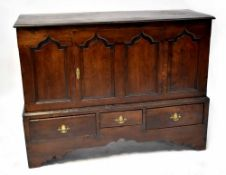 A Georgian oak Lancashire chest with single door over three drawers,