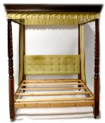 A mahogany four-poster bed with a dentil moulded open canopy,
