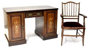 An Edwardian inlaid rosewood kneehole desk comprising single drawer and pair of cupboard doors with