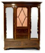 An Edwardian inlaid mahogany triple compactum wardrobe,