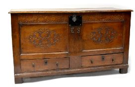 A Georgian carved oak mule chest with iron escutcheon,