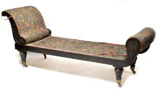 A Victorian mahogany day bed with scroll arm,