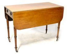 A 19th century mahogany Pembroke table with single frieze drawer opposed by a dummy drawer,